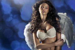 Woman angel with hundreds flashes in the background Royalty Free Stock Photos