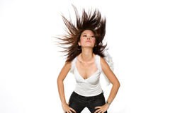 Woman with angel wings flinging her hair. Portrait of young woman flinging here hair wildly wearing a pair of angel wings Royalty Free Stock Images