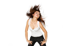Woman with angel wings flinging her hair sideways. Portrait of young woman flinging here hair wildly wearing a pair of angel wings Stock Image