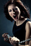 Woman anger face. Pretty woman anger face over dark Stock Photo