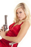 Woman anger gun lean back Stock Photo