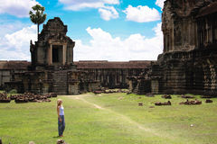 Woman in Angkor wat complex, Cambodia. Royalty Free Stock Photography