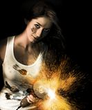 Woman With Angle Grinder Spraying Sparks Stock Photography
