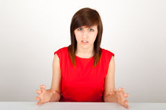 The woman is angrily sitting at the table Royalty Free Stock Image