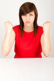 The woman is angrily sitting at the table Stock Photos