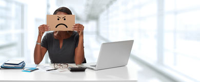 Woman with angry cardboard on face Stock Image