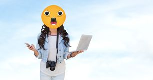 Woman with angry emoji holding laptop. Digital composite of Woman with angry emoji holding laptop royalty free illustration