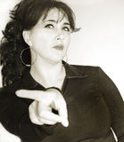 Woman with angry facial expression. Pointing with her finger Royalty Free Stock Photo