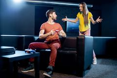 Woman angry at her boyfriend playing video games royalty free stock photos