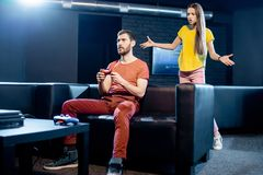 Woman angry at her boyfriend playing video games stock images