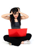 Woman angry with her computer Royalty Free Stock Photography