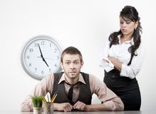 Woman angry with a male coworker. Woman at work wngry with male coworker Stock Photography