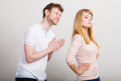 Woman angry on man apologizing her. Royalty Free Stock Photo