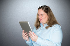 Woman is angry about a message she is reading Royalty Free Stock Photo