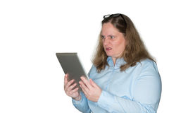 Woman is angry about a message she is reading Stock Images