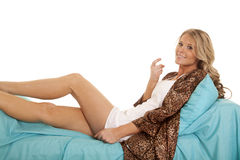 Woman animal print robe lay blue sheet come here Stock Photos