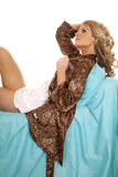 Woman animal print robe lay blue sheet serious side Royalty Free Stock Photos