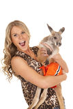Woman in animal print shirt hold kangaroo happy Stock Photo