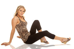 Woman animal print tank top sit on floor Royalty Free Stock Photos