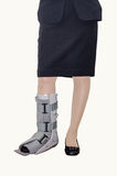 Woman with an ankle brace Royalty Free Stock Photo