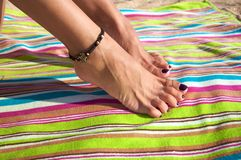 Woman ankle with bracelet Stock Photography