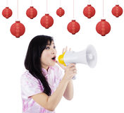 Woman Announcing Chinese New Year Royalty Free Stock Images