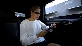 Woman annoyed by bad service and glitches, going to throw fake phone out of car. Stock photo stock photos