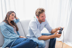 Woman annoyed that her partner is playing video games Royalty Free Stock Photo