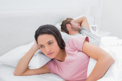 Woman annoyed that her partner is sleeping Stock Images