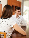 Woman answer questions of outreach worker. With paper at home Royalty Free Stock Photos