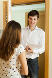 Woman answer questions of outreach worker with paper Royalty Free Stock Photo