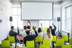 Business woman answering during educational team meeting or corporate training with woman speaker or coach. Woman answering during educational team meeting or royalty free stock photo