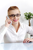 Woman answering the phone. Royalty Free Stock Photo