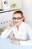 Woman answering the phone. Royalty Free Stock Photos
