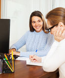 Woman answering questions of employee Stock Image