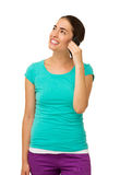 Woman Answering Smart Phone While Looking Up Stock Images
