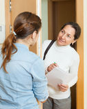Woman answers the questions in door Stock Photos
