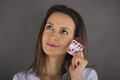 Woman with anti-baby pill Royalty Free Stock Images