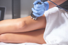 Woman anti-cellulite treatment. At medical spa center Stock Image