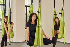 Woman anti-gravity aerial yoga portrait Royalty Free Stock Images