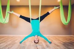 Woman on antigravity yoga exercise Royalty Free Stock Image