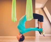Woman on antigravity yoga exercise Royalty Free Stock Images
