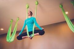 Woman on antigravity yoga exercise Stock Image