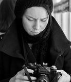 Woman with antique camera Stock Photos
