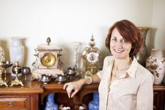 Woman with antique collection Stock Images