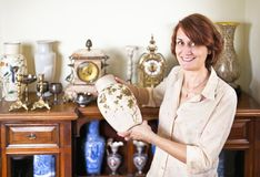 Woman with antique collection Stock Photography