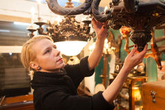 Woman in antique store Stock Photos
