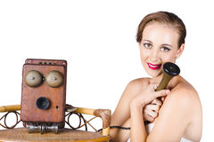 Woman with antique telephone Royalty Free Stock Photo