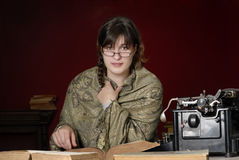 Woman with antique typewriter and books Royalty Free Stock Photos
