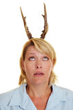Woman with antlers on her head Stock Images